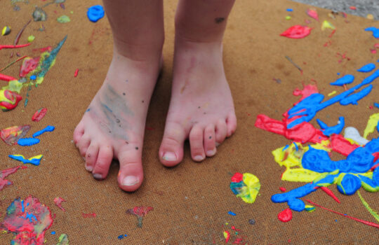 Childs feet with paint